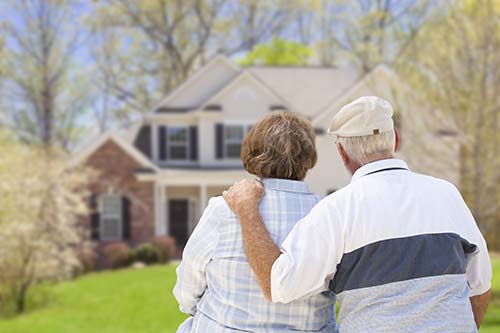 Elderly couple looking at their home
