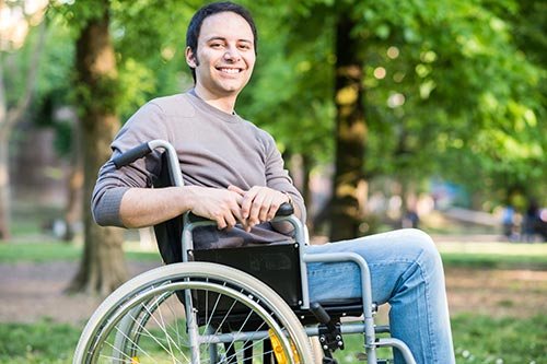 Man in wheelchair smiling